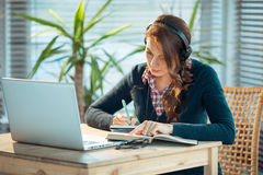 Girl with headphones and laptop Royalty Free Stock Images