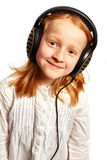 Girl with headphones in a light top view. Young Girl with headphones in a light top view royalty free stock images