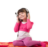 Girl with headphones is listen to the music Royalty Free Stock Photos