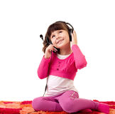 Girl with headphones is listen to the music Royalty Free Stock Images