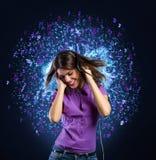 Girl with headphones listen to music Stock Image