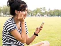 Girl with headphones. Listening music Royalty Free Stock Photos