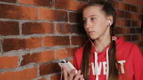 Girl with headphones listening music stock video