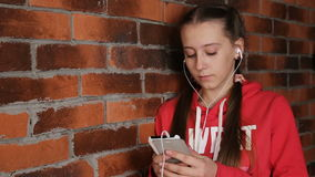 Girl with headphones listening music stock video footage