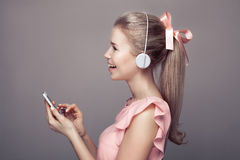 Girl with headphones listening music and having fun. Stock Photos