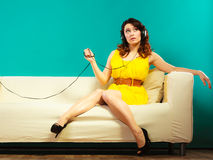 Girl in headphones listening music mp3 relaxing Royalty Free Stock Photos