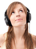 Girl with headphones listening to music Stock Images