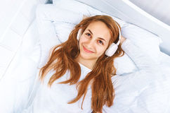 Girl a headphones on listening to the music Stock Photography