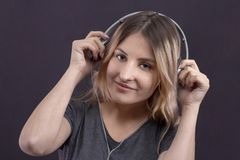 Girl in headphones listening to music and enjoying smiling royalty free stock photos