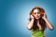 Girl in headphones listening to music. Royalty Free Stock Image