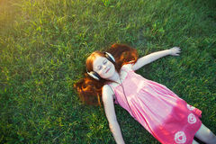 Girl with headphones listening to music Stock Photography
