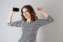 Girl in headphones listening to music Stock Image