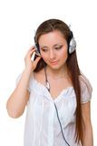 Girl in headphones listens to music Stock Image