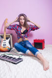 Girl in headphones listens to music. electric. Royalty Free Stock Images