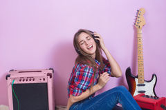 Girl in headphones listens to music. electric. Royalty Free Stock Photos