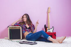 Girl in headphones listens to music. electric. Royalty Free Stock Photography