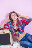 Girl in headphones listens to music. electric. Stock Photos