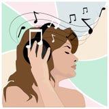 Girl in headphones listens to music Stock Photo