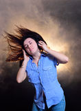 Girl in headphones listens to music in the studio Royalty Free Stock Photography
