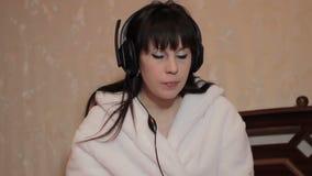 Girl in headphones stock video footage