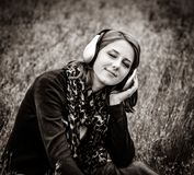 Girl with headphones at meadow royalty free stock photos