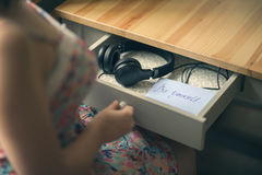 The girl with headphones and  message be yourself. The inscription on the paper be yourself. Royalty Free Stock Images
