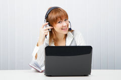Girl in headphones with a microphone Stock Images