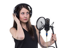 Girl in headphones with microphone Royalty Free Stock Photography