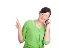 Girl in headphones and MP3 player Royalty Free Stock Photography