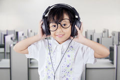 Girl with headphones in the multimedia room Royalty Free Stock Images