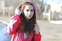 Girl with headphones and music player Stock Photo