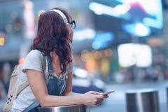 Girl with headphones in New York Stock Photo