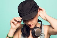 Girl with headphones and positive attitude. Woman with smiling music headphones royalty free stock image