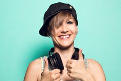 Girl with headphones and positive attitude. Woman with smiling music headphones stock photos