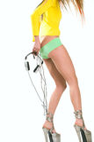 Girl with headphones pulling panties off Stock Images