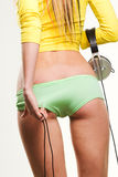 Girl with headphones pulling panties off Stock Image