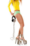 Girl with headphones pulling panties off Royalty Free Stock Photos