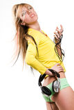 Girl with headphones pulling panties off Royalty Free Stock Photography