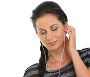 Girl with headphones relaxing by listening music Royalty Free Stock Image