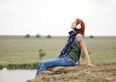 Girl with headphones at rock Royalty Free Stock Image