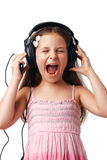Girl with Headphones Screaming. Little cute girl with headphones screaming on white background Stock Photo