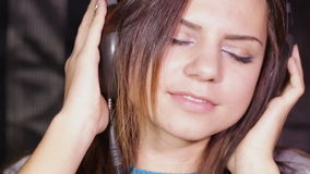 Girl in headphones with Serenity stock video footage
