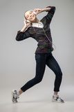 Girl With Headphones Singing and dancing Royalty Free Stock Photos