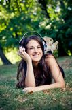Girl with headphones smiling Stock Photography