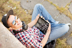 Boy with headphones and tablet pc Royalty Free Stock Images