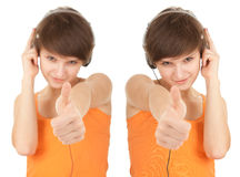 Girl in headphones with thumb up Royalty Free Stock Photo
