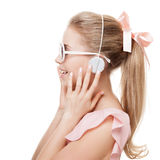 Girl with headphones on the white background. Isolated. Royalty Free Stock Image