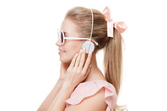 Girl with headphones on the white background. Isolated. Stock Photo