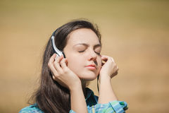 Girl with headphones Royalty Free Stock Images