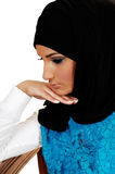 Girl with headscarf. A young beautiful girl with a black headscarf and nice makeup, with her Royalty Free Stock Image